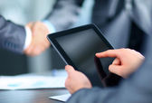 Businessman holding digital tablet — Stock Photo