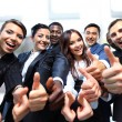 Successful business with thumbs up and smiling — Stock Photo #22905368