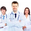 Stock Photo: Smiling medical doctors with stethoscopes