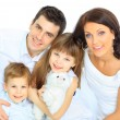 Stock Photo: Beautiful happy family - isolated over a white background