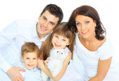 Beautiful happy family - isolated over a white background — Stockfoto