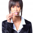 Girl holding a card with photo her tongue in front of her mouth — Stock Photo #22914176