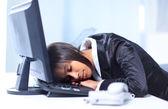Businesswoman sleeping in her office — Stock Photo