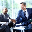 Business shaking hands at a meeting — Stock Photo