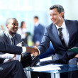 Royalty-Free Stock Photo: Business people shaking hands, finishing up a meeting