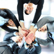 Small group of business joining hands, low angle view. — Stock Photo #22927066