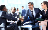 Business shaking hands, finishing up a meeting — Stok fotoğraf