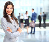 Business woman portrait smiling in an officeq — Stock Photo