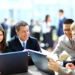Business meeting - manager discussing work with his colleagues — Stock Photo #22949166