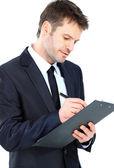 Empresario escribiendo en portapapeles elegante traje y corbata isola — Foto de Stock
