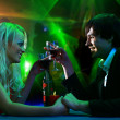 Young pair in the disco — Stock Photo #2531391