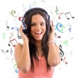 Young woman with headphones listening music — Stock Photo