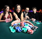 Attractive, bet, betting, card, casino, caucasian, chance, chips, dress, drink, elegant, excited, fashionable, female, formal, friends, fun, gamble, gambler, gambling, game, green, group, happy, — Stock Photo