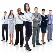 Group of business standing in huddle, smiling, low angle view — Stock Photo #25792179