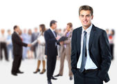 Uomo d'affari e la sua squadra isolato su uno sfondo bianco — Foto Stock