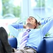Businessman relaxing in his office — Stock Photo