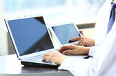 Business people working with digital tablet and laptop — Stock Photo