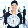 Young attractive business woman holding clock — Stockfoto