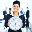 Young attractive business woman holding clock — Foto Stock