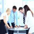Business meeting - manager discussing work with his colleagues — Stock Photo #30245345