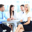 Portrait of a smiling young attractive business woman in a meeting — Stock Photo