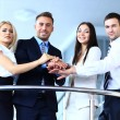 Portrait of positive business group standing on stairs of modern building — Stock Photo
