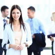 Business woman with her team at the office — Stock Photo #30245963