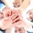Stock Photo: Small group of business people joining hands, low angle view.