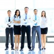 Portrait of businessman leading his team at office — Stockfoto