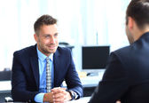 Happy business people talking on meeting at office — Stock Photo