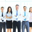 Portrait of businessman leading his team at office — Stock Photo