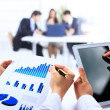 Business work-group analyzing financial data in office — ストック写真