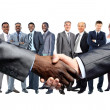 Foto Stock: AfricAmericbusinessmshaking hands with caucasian