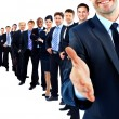 Business group in a row. leader with open hand and ready to shake your hand — Stok fotoğraf