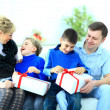 Happy family opening Christmas presents — Stock Photo #41439001