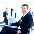 Casual businessman working in office, sitting at desk. — Stock Photo #41439431