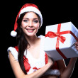 Santa girl with Christmas gifts — Stock Photo #41439837