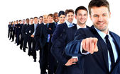 Business group in a row. leader pointing his finger at you — Stock Photo