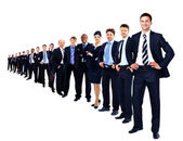 Business group in a row isolated over a white background — Stock Photo