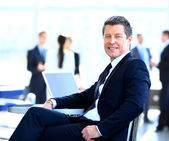 Casual businessman working in office, sitting at desk. — Stock Photo