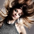 Portrait of beautiful and fashion model woman with blown hairs — Stock Photo