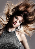 Portrait of beautiful and fashion model woman with blown hairs — Stok fotoğraf