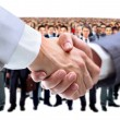Handshake und Business team — Stockfoto
