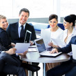 Group of happy business people in a meeting at office — Stock Photo #41649447