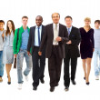 Happy young businessman standing in front of her team — Stock Photo #4178708