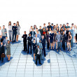 Business people team with world map — Stock Photo #42436577