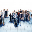 Foto Stock: Business people team with world map