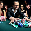 "Poker player going ""all in"" pushing his chips forward — Stock Photo #42436709"