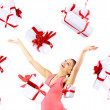 Excited attractive woman with many gift boxes and bags — Stock Photo #4262713