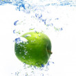 A background of bubbles forming in blue water after apple are dropped — Stock Photo #4263751